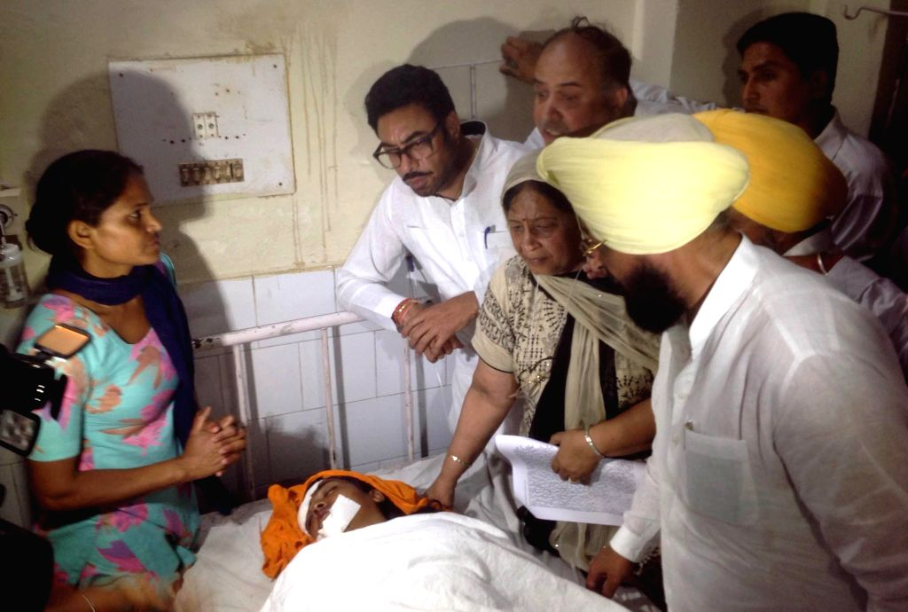 Punjab Congress chief Partap Singh Bajwa visits the mother of a 13-year-old girl who jumped out of a moving bus while trying to escape molestation near Moga town of Punjab, on April 30, 2015. ... - Partap Singh Bajwa