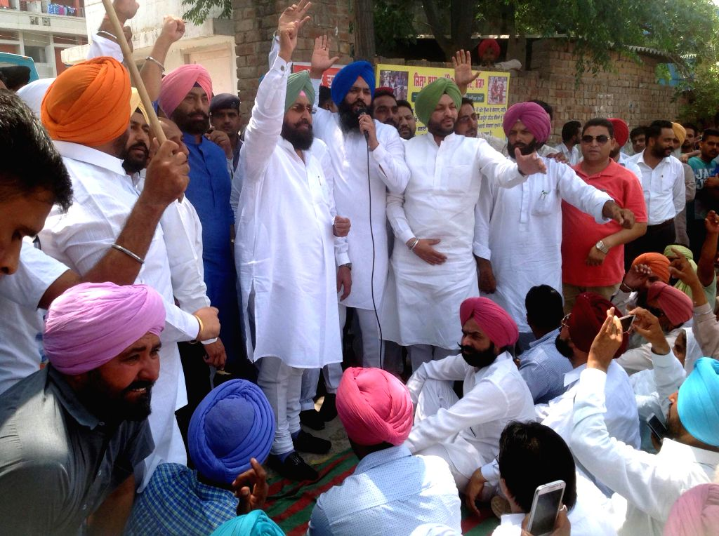 Punjab Congress chief Pratap Singh Bajwa participates in a demonstration against the death of a 13-year-old girl who jumped out of a moving bus to escape molestation on 30th April 2015 near ... - Pratap Singh Bajwa
