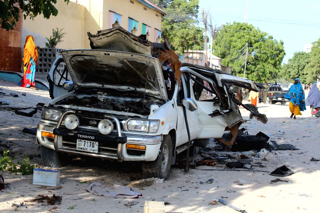 MOGADISHU, April 18, 2016 - The site of a car bomb explosion is seen in Mogadishu, capital of Somalia, April 18, 2016. At least four people were killed in two separate incidents in northern Mogadishu ...