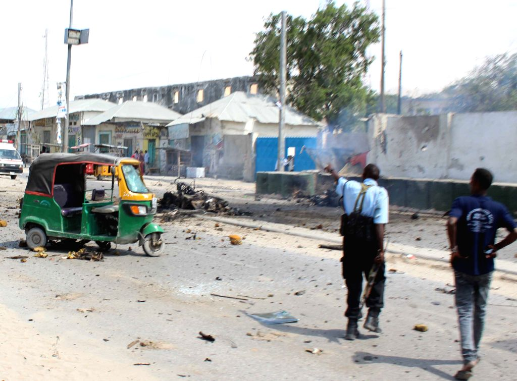 MOGADISHU, July 31, 2016 - Photo taken on July 31, 2016 shows the site of a car bomb explosion in Mogadishu, capital of Somalia. At least five people were killed and several others were injured on ...