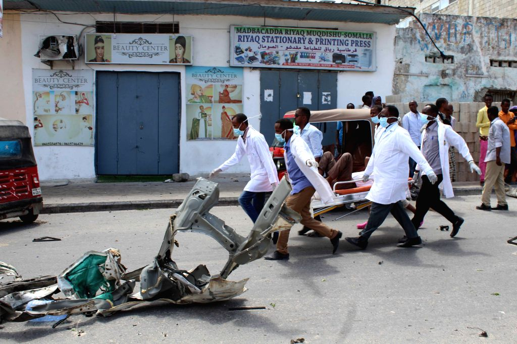 MOGADISHU, July 7, 2018 - Medical personnel carry a wounded man at the scene of an explosion in Mogadishu, Somalia, July 7, 2018. At least 12 people were killed and 17 others injured in twin blasts ...