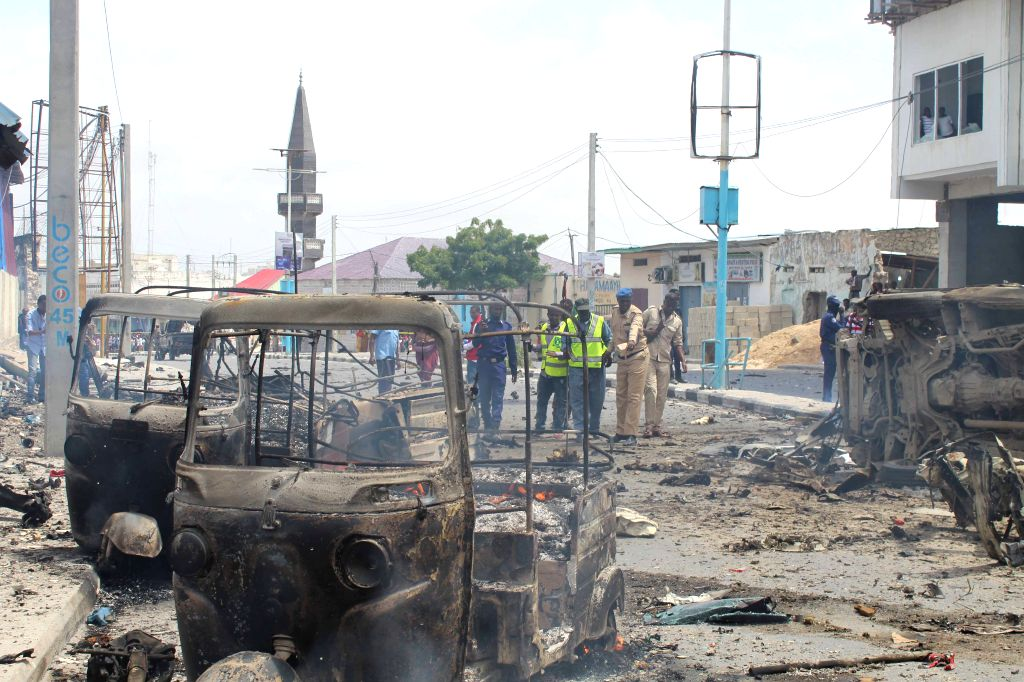 MOGADISHU, July 7, 2018 - Photo taken on July 7, 2018 shows motors burning at the scene of an explosion in Mogadishu, Somalia. At least 12 people were killed and 17 others injured in twin blasts in ...