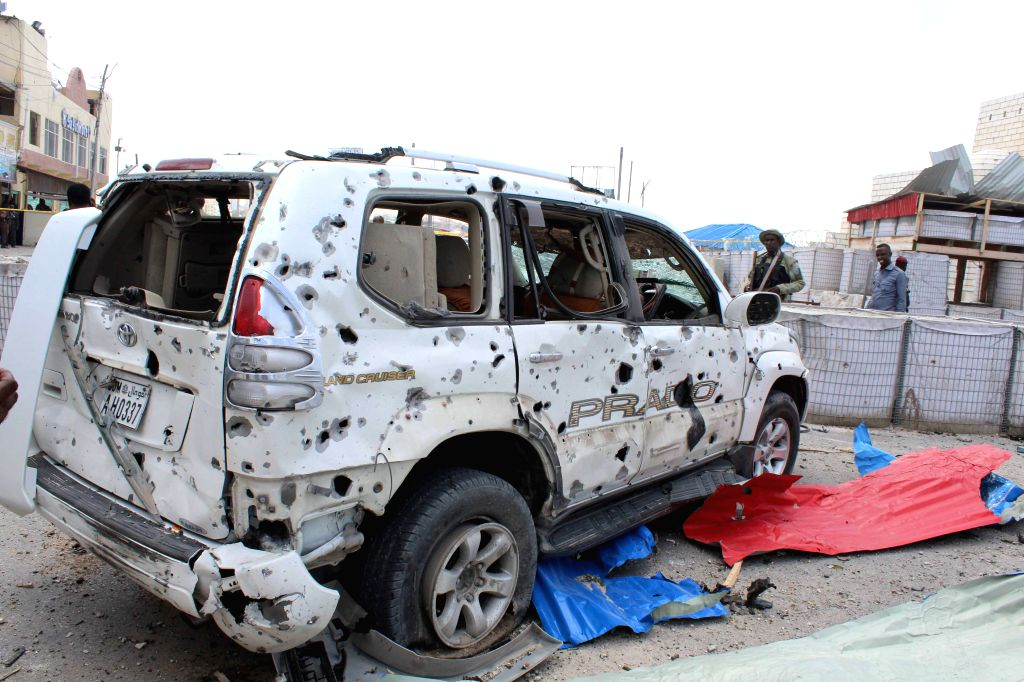 MOGADISHU, July 7, 2018 - Photo taken on July 7, 2018 shows a destroyed vehicle at the scene of an explosion in Mogadishu, Somalia. At least 12 people were killed and 17 others injured in twin blasts ...