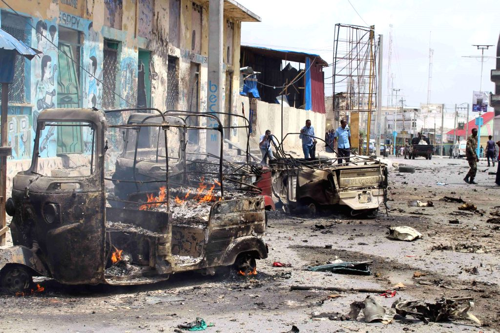 MOGADISHU, July 7, 2018 - Photo taken on July 7, 2018 shows motors burning at an explosion site in Mogadishu, Somalia. At least 12 people were killed and 17 others injured in twin blasts in Somalia's ...