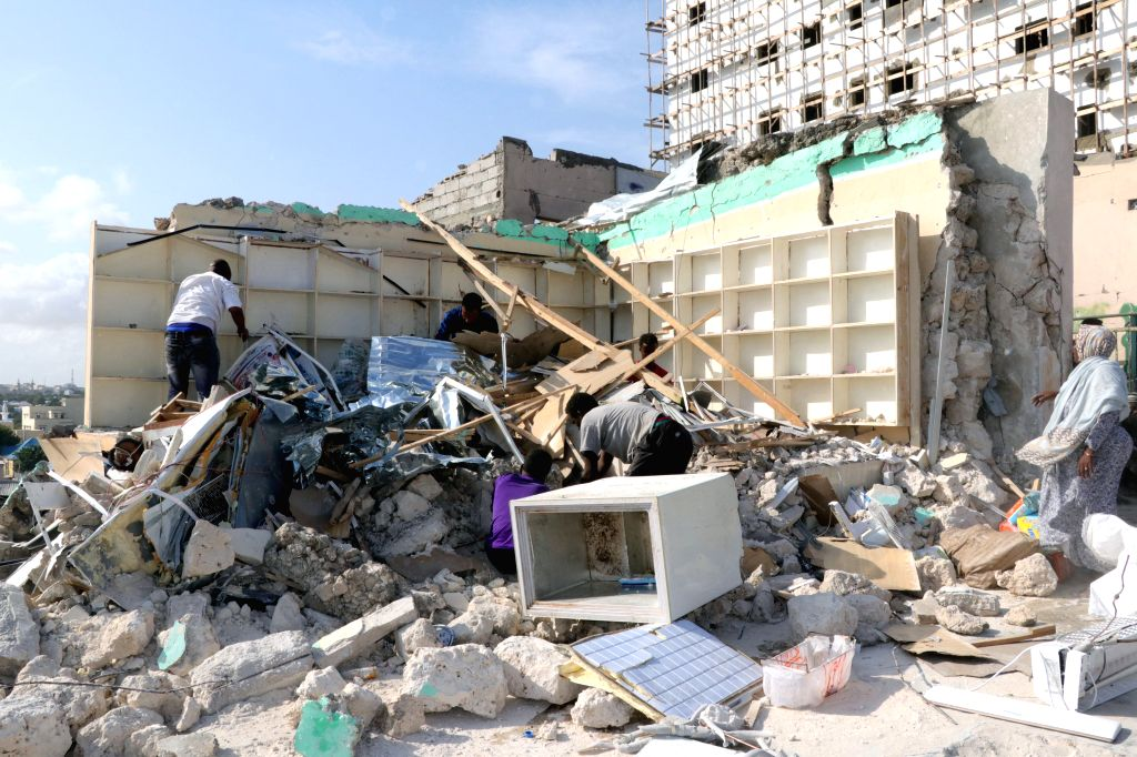 MOGADISHU, June 15, 2019 - Somalis sift through the remains of their belongings after a car bomb blast in Mogadishu, capital of Somalia, on June 15, 2019. At least 10 people were killed and 26 others ...