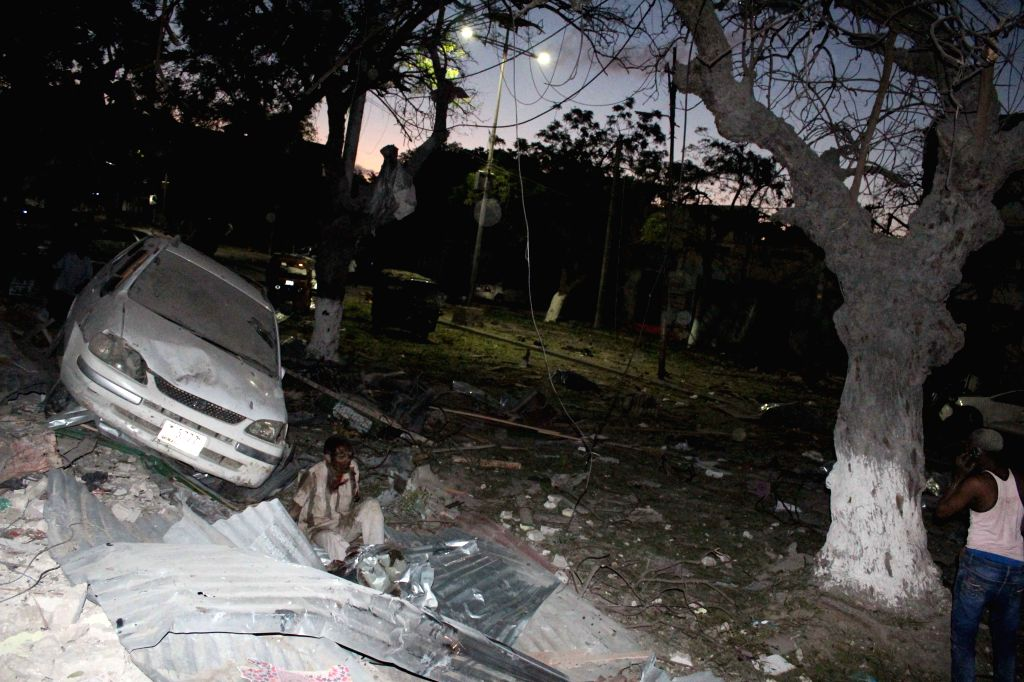 MOGADISHU, June 2, 2016 - A wounded man is seen near the site of a suicide car bomb attack at Ambassador Hotel in Mogadishu, capital of Somalia, June 1, 2016. At least 10 people have been killed and ...