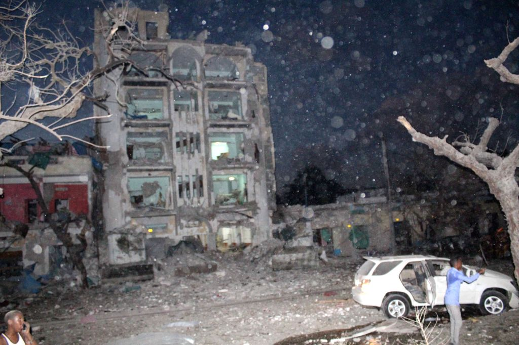 MOGADISHU, June 2, 2016 - Photo taken on June 1, 2016 shows the wreckage of Ambassador Hotel after a suicide car bomb attack in Mogadishu, capital of Somalia. At least 10 people have been killed and ...