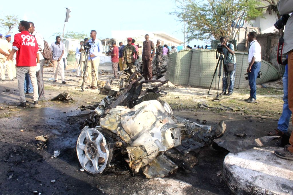 MOGADISHU, March 25, 2018 - Photo taken on March 25, 2018 shows the explosion site in Mogadishu, capital of Somalia. At least five people were killed and several others injured when a car laden with ...