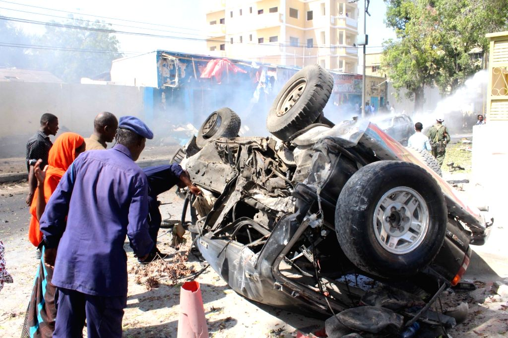MOGADISHU, Oct. 1, 2016 - A policeman checks a vehicle at the explosion site in Mogadishu, Somalia, on Oct. 1, 2016. At least four people were killed and several others injured as an explosion hit a ...