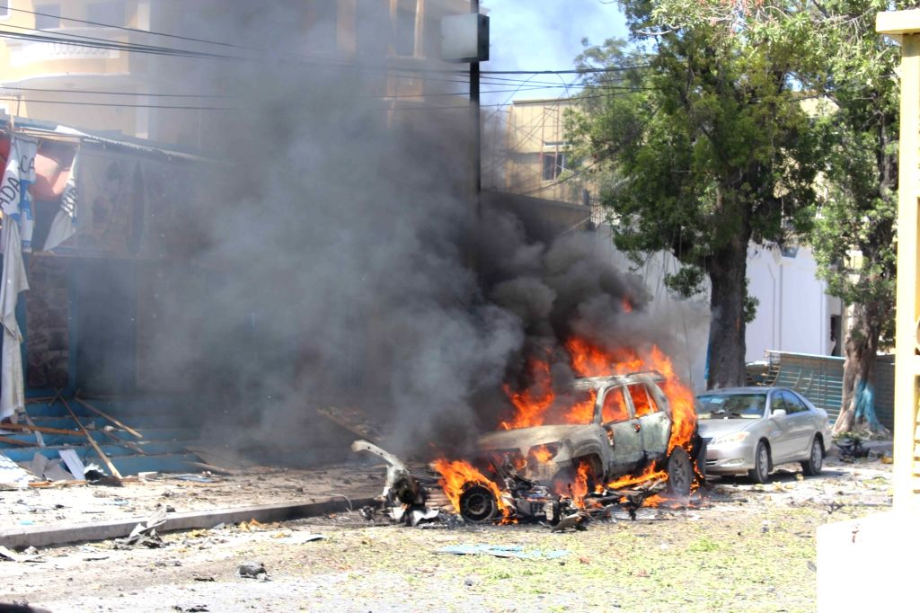 MOGADISHU, Oct. 1, 2016 - Photo taken on Oct. 1, 2016 shows the explosion site in Mogadishu, Somalia. At least four people were killed and several others injured as an explosion hit a restaurant in ...