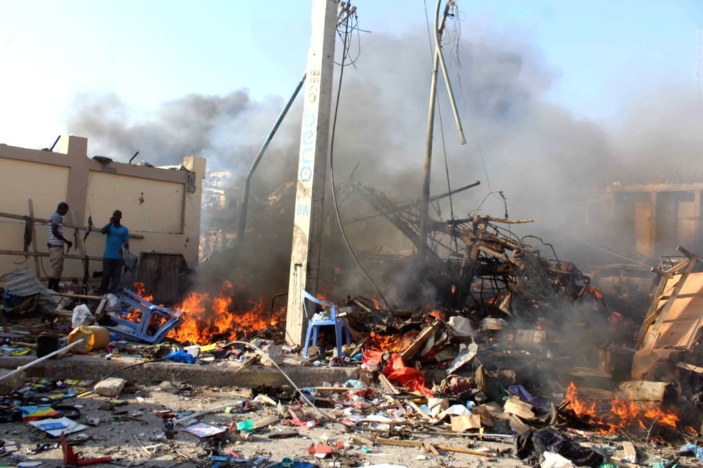 MOGADISHU, Oct. 14, 2017 - Photo taken on Oct. 14, 2017 shows the explosion site near Safari hotel in Mogadishu, capital of Somalia. At least 40 people were killed and several others injured in a ...
