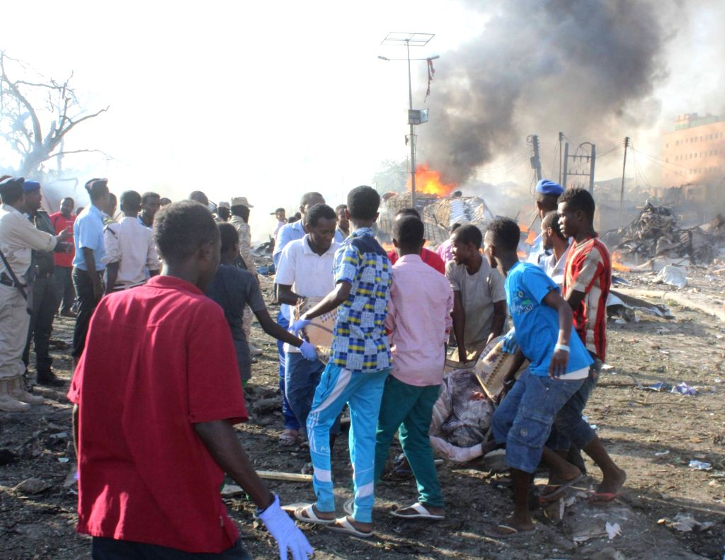 MOGADISHU, Oct. 14, 2017 - Rescuers work at the explosion site near Safari hotel in Mogadishu, capital of Somalia, on Oct. 14, 2017. At least 40 people were killed and several others injured in a ...
