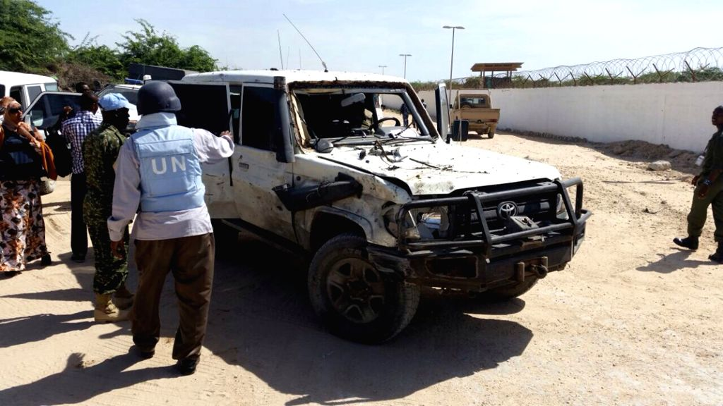 Photo taken on Dec. 3, 2014 shows the damaged vehicle outside the airport in Mogadishu, capital of Somalia. At least four people were killed in a suicide car bomb attack against a UN ...