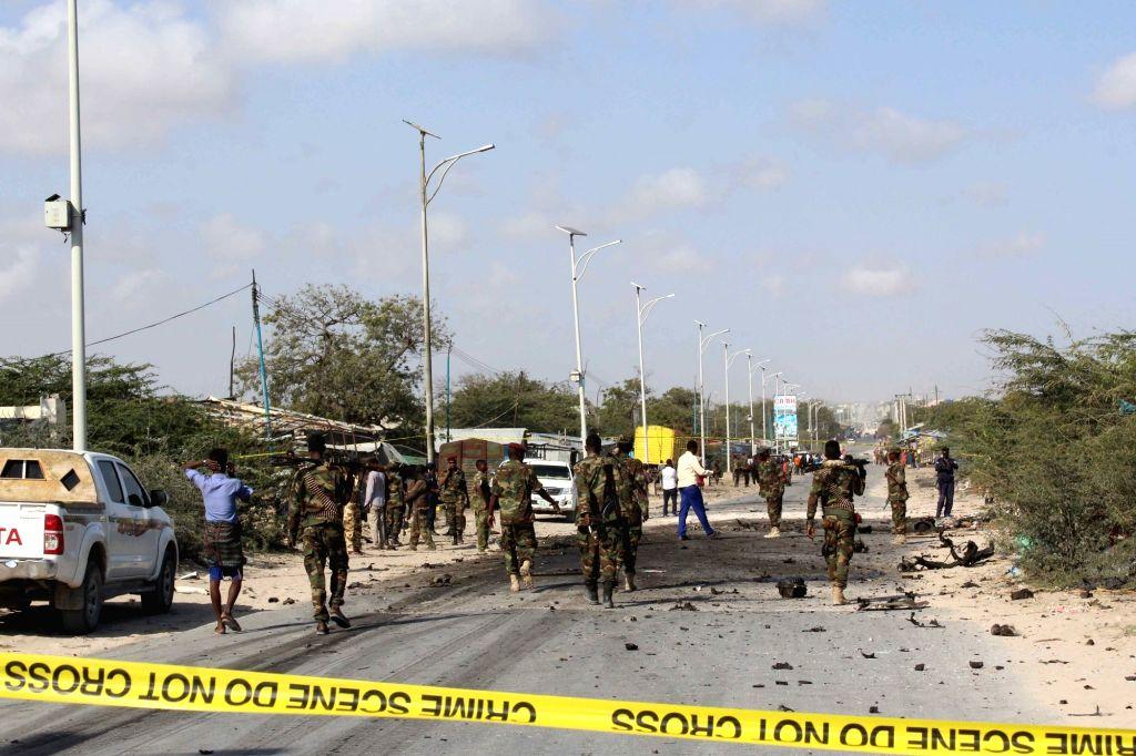 MOGADISHU, Sept. 18, 2016 - Somali security force members investigate a suicide attack scene in Mogadishu, Somalia, Sept. 18, 2016. A senior Somali military commander and seven of his bodyguards were ...