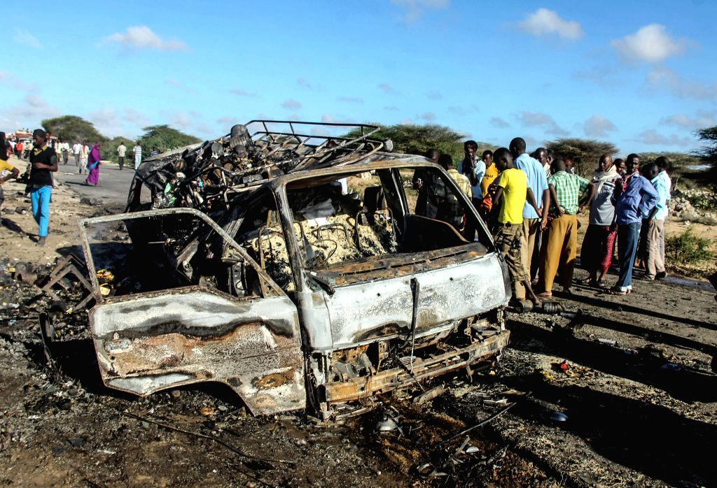 Photo taken on Sept. 8, 2014 shows the site of a suicide carbomb targeting a convoy of the African Union Mission in Somalia (AMISOM) on a road linking Mogadishu ..