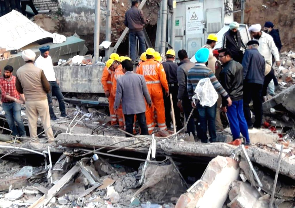 Mohali: A team of National Disaster Response Force (NDRF) carries out rescue and search operations after a three-storey building collapsed in Punjab's Mohali on Feb 8, 2020. The building, located on the Kharar-Landran road, came down when a JCB machi