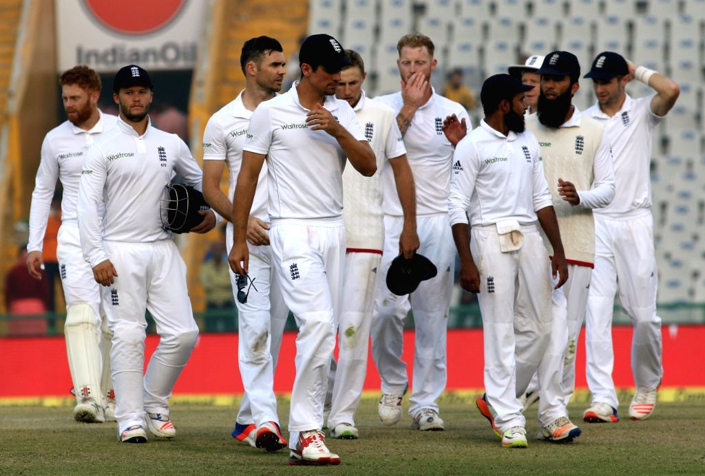 Mohali: England players walk back to the pavilion after loosing the third test match against India at Punjab Cricket Association IS Bindra Stadium, Mohali on Nov 29, 2016.