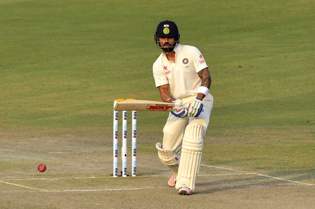 :Mohali: Indian captain Virat Kohli in action during the 1st Test match between India and South Africa at Punjab Cricket Association Stadium in Mohali on Nov. 6, 2015. (Photo: IANS).