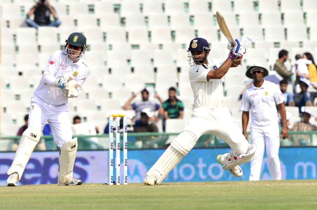 :Mohali: Indian cricketer Ajinkya Rahane in action during the 1st Test match between India and South Africa at Punjab Cricket Association Stadium in Mohali on Nov. 5, 2015. (Photo: IANS).