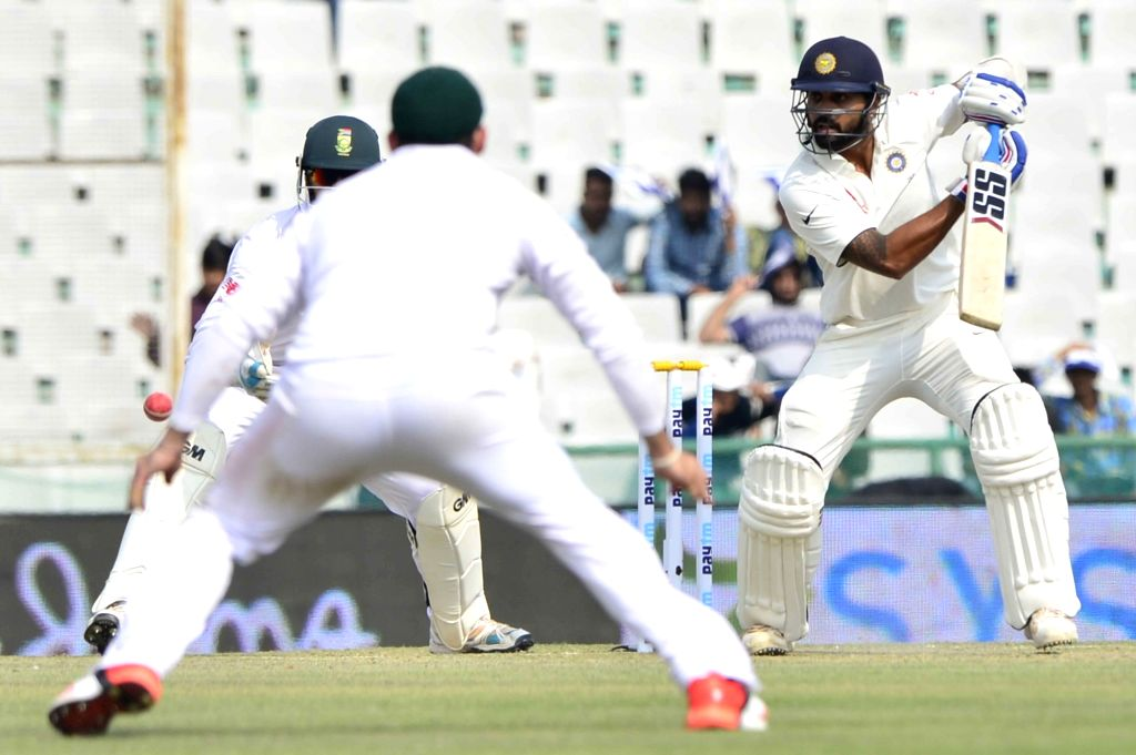 :Mohali: Indian cricketer Murali Vijay in action during the 1st Test match between India and South Africa at Punjab Cricket Association Stadium in Mohali on Nov. 5, 2015. (Photo: IANS).