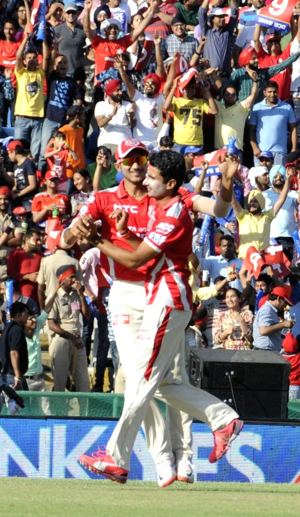 Kings XI Punjab celebrate fall of a wicket during an IPL-2015 match between Mumbai Indians and Kings XI Punjab at the Punjab Cricket Association Stadium, in Mohali on May 3, 2015.