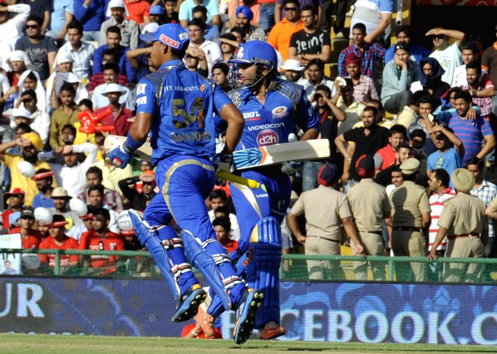 Mumbai Indians batsman Parthiv Patel and Lendl Simmons in action during an IPL-2015 match between Mumbai Indians and Kings XI Punjab at the Punjab Cricket Association Stadium, in Mohali on ... - Parthiv Patel