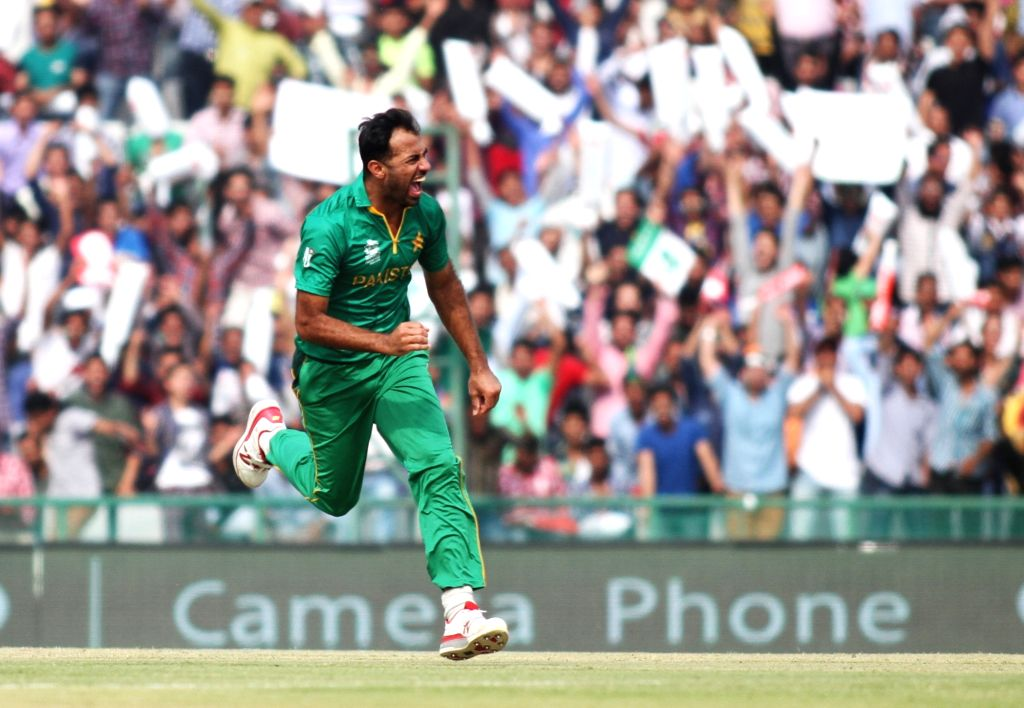 Mohali: Pakistan's bowler Wahab Riaz celebrates fall of a wicket during a WT20 match between Australia and Pakistan at Punjab Cricket Association IS Bindra Stadium in Mohali, on March 25, 2016. (Photo: Surjeet Yadav/IANS) - Wahab Riaz and Surjeet Yadav