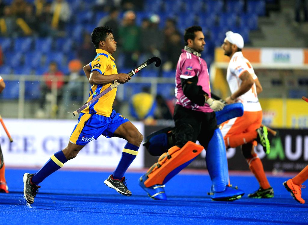 Players in action during a Hockey India League match between Kalinga Lancers and Punjab Warriors in Mohali, on Jan 25, 2015.