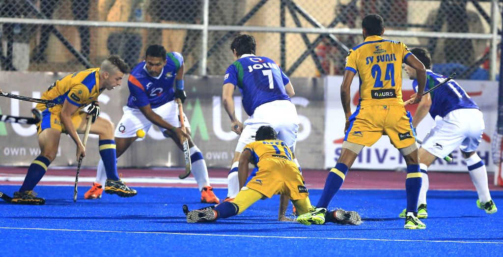Players in action during a Hockey India League match between Uttar Pradesh Wizards and Punjab Warriors in Mohali, on Jan 26, 2015.