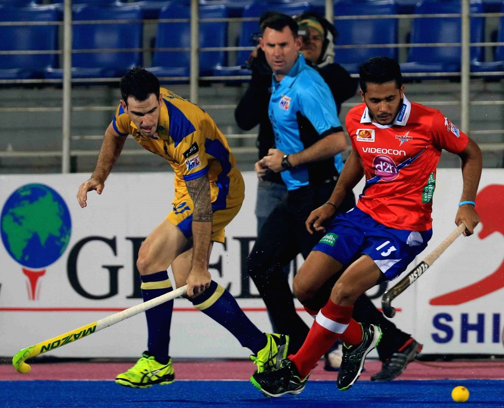 Players in action during a Hockey India League match between Punjab Warriors and Dabang Mumbai in Mohali, on Feb 19, 2015. (Photo : IANS)
