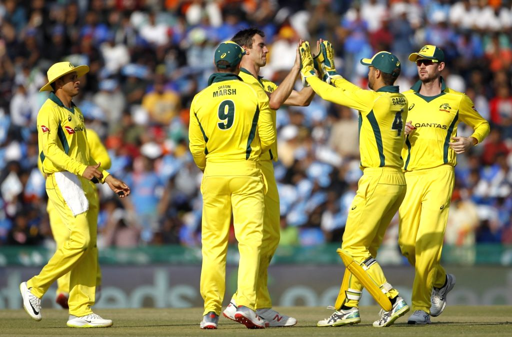 Mohali (Punjab): Australia's Pat Cummins celebrates the wicket of Shikhar Dhawan with teammates during the fourth ODI match between India and Australia at Punjab Cricket Association IS Bindra Stadium ... - Shikhar Dhawan