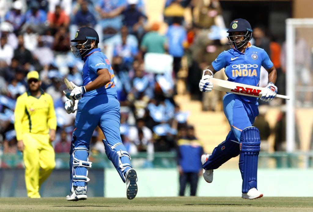 Mohali (Punjab): India's Rohit Sharma and Shikhar Dhawan during the fourth ODI match between India and Australia at Punjab Cricket Association IS Bindra Stadium in Mohali, Punjab on March 10, 2019. (Photo: Surjeet Yadav/IANS) - Shikhar Dhawan, Rohit Sharma and Surjeet Yadav