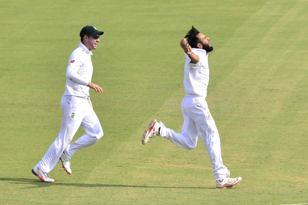 :Mohali: South African cricketer Imran Tahir celebrate fall of a wicket during the 1st Test match between India and South Africa at Punjab Cricket Association Stadium in Mohali on Nov. 7, 2015. ...