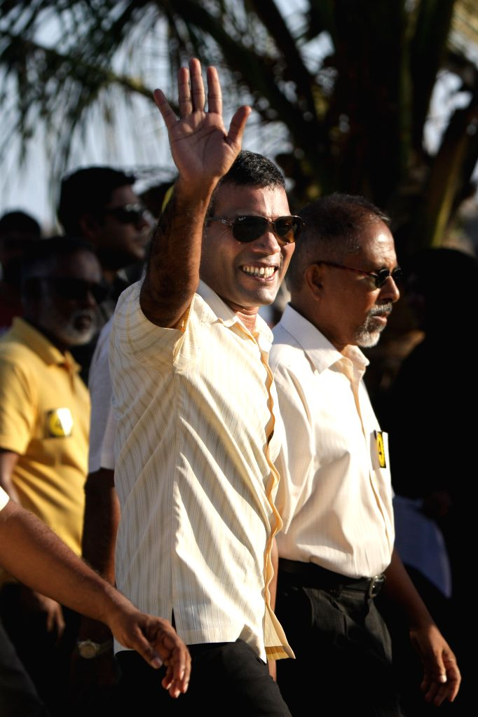 :Mohamed Nasheed (C), candidate of Maldivian Democratic Party (MDP), takes part in a rally in Male, capital of Maldives, Nov. 8, 2013. Maldives' presidential ...