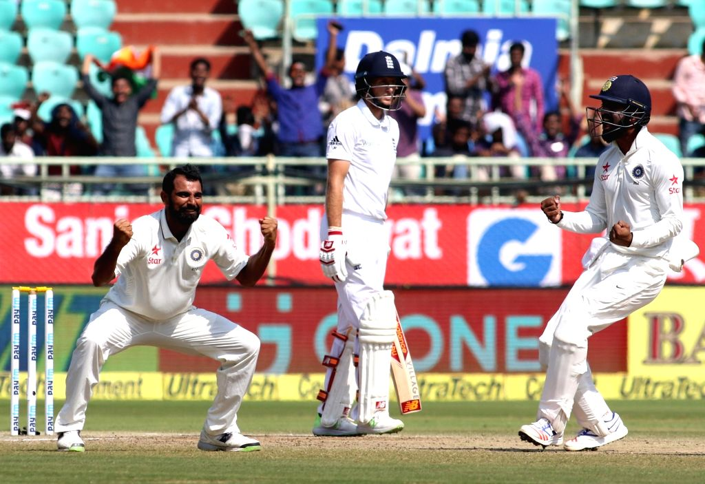 Mohammd Shami of India celebrates wicket of Joe Root of England during the Day-5 of the second test cricket match between India and England at the Dr. YS Rajasekhara Reddy ACA-VDCA ... - Rajasekhara Reddy A