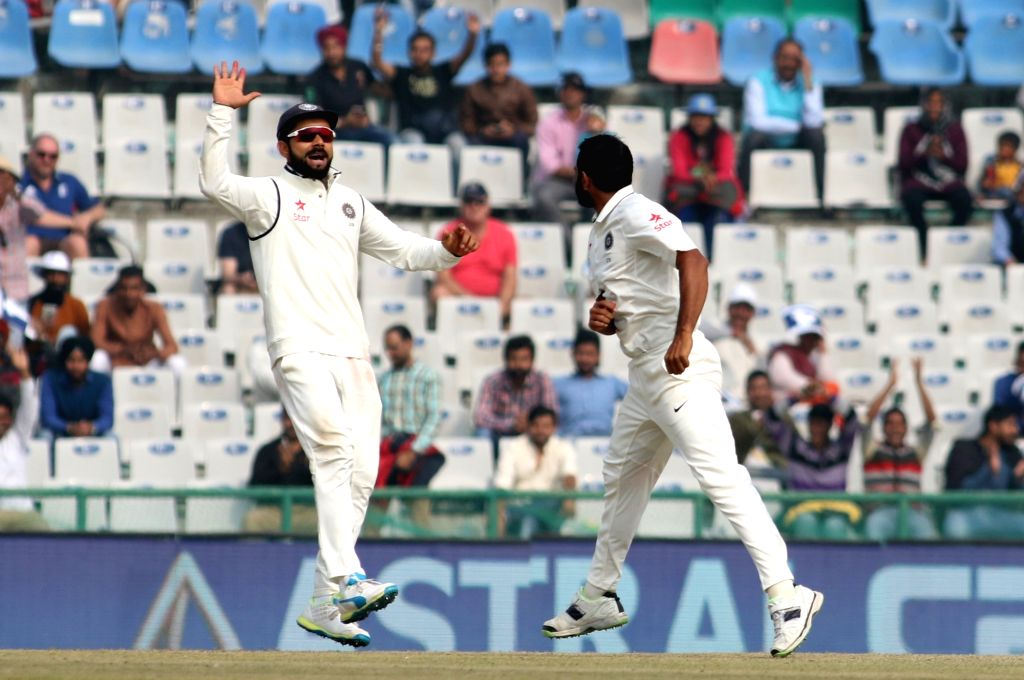 Mohammed Shami and Virat Kohli  of India celebrate fall of Jos Buttler's wicket on Day 4 of the third test match between India and England at Punjab Cricket Association IS Bindra Stadium, ... - Virat Kohli