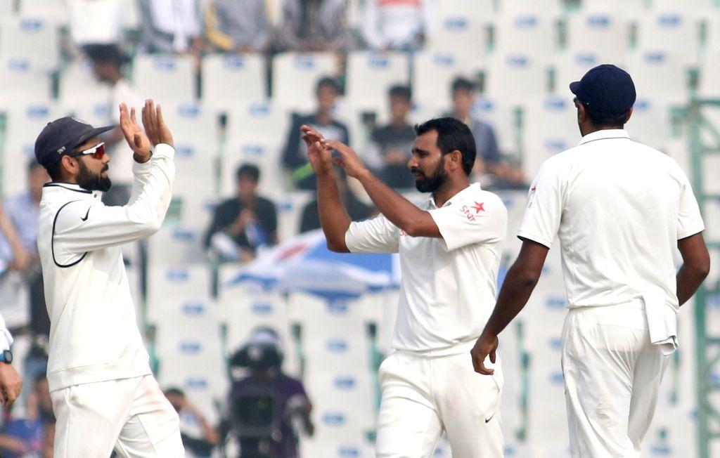 Mohammed Shami and Virat Kohli  of India celebrate fall of Adil Rashid's wicket on Day 4 of the third test match between India and England at Punjab Cricket Association IS Bindra Stadium, ... - Virat Kohli
