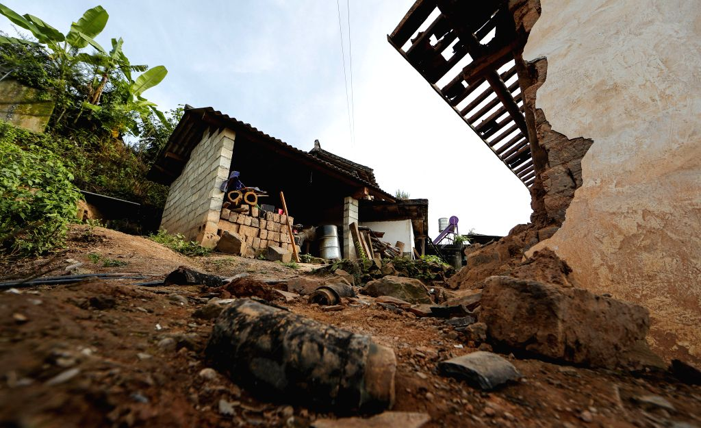 MOJIANG, Sept. 8, 2018 - Photo taken on Sept. 8, 2018 shows the damaged house at Tongguan Township of Mojiang Hani Autonomous County, southwest China's Yunnan Province. Fourteen people suffered minor ...