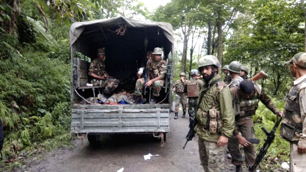 Mon:: The mortal remains of the two Assam Rifles soldiers who were reportedly killed in an ambush by terrorists, being taken away, in Mon district of Nagaland on May 25, 2019. The attack left three other soldiers injured. (Photo: IANS)