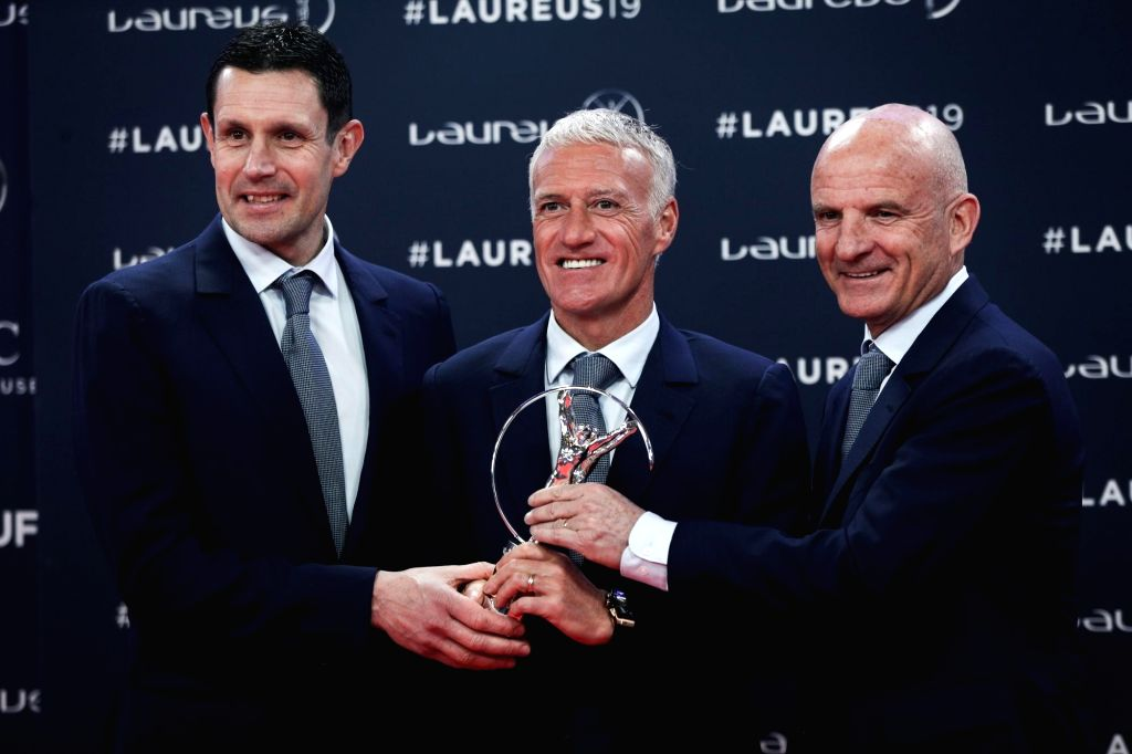 MONACO, Feb. 19, 2019 - Didier Deschamps (C), manager of France men's national football team, goalkeeper coach Franck Raviot (L) and assistant coach Guy Stephan show the trophy after the France World ...