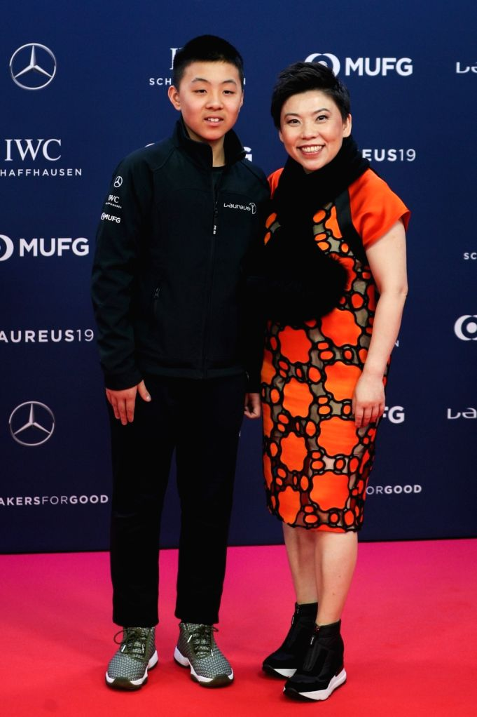 MONACO, Feb. 19, 2019 - Laureus Academy Member, Chinese table tennis Olympic champion Deng Yaping and her son Lin Hanming pose on the red carpet at the 2019 Laureus World Sports Awards ceremony in ...