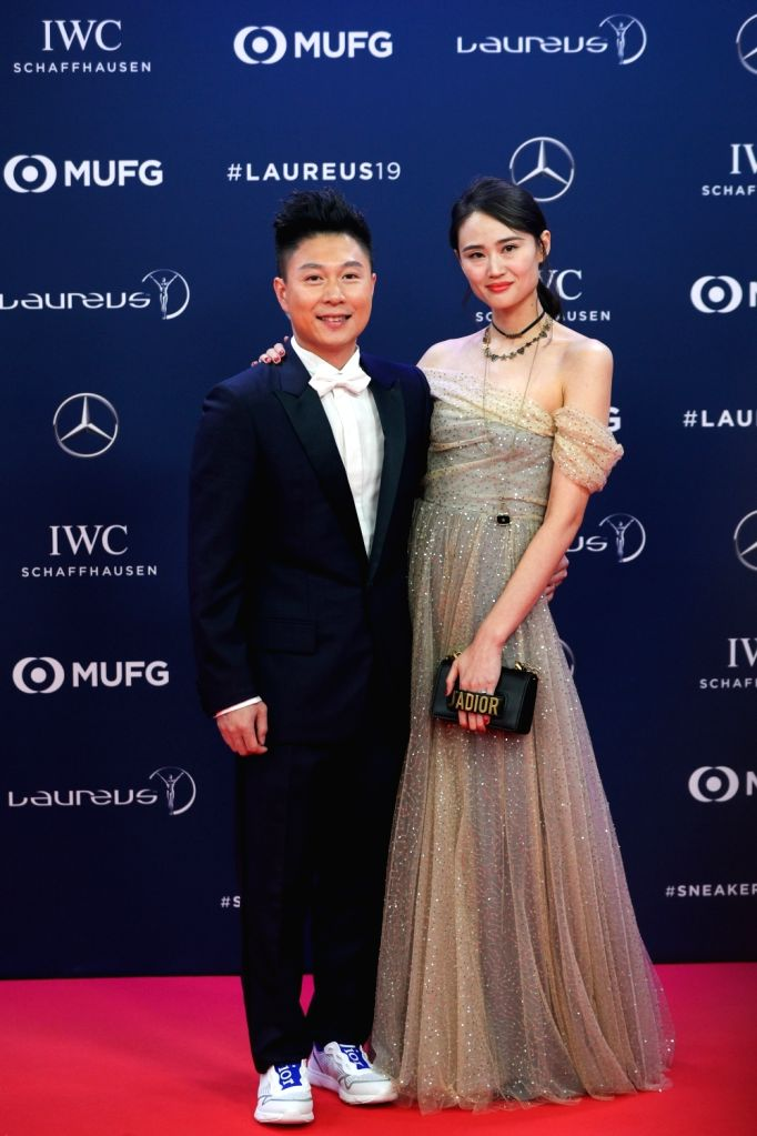 MONACO, Feb. 19, 2019 - Laureus Academy Member, Chinese gymnastics Olympic champion Li Xiaopeng and his wife Li Anqi pose on the red carpet at the 2019 Laureus World Sports Awards ceremony in Monaco, ...