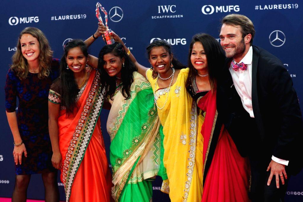 MONACO, Feb. 19, 2019 - Rose Gastler, Neeta Kumari, Radha Kumari, Konika Kumari, Hema Kumari and Franz Gastler of Indian sport for development programme Yuwa, show the trophy after winning the Sport ...
