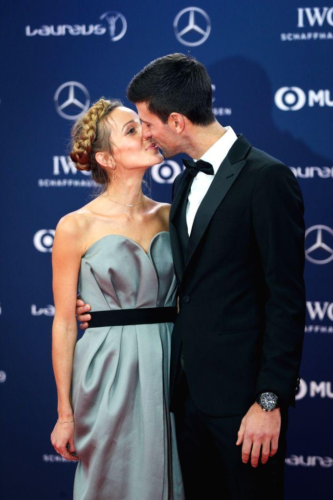 MONACO, Feb. 19, 2019 - Serbian tennis player Novak Djokovic and his wife Jelena Djokovic kiss on the red carpet at the 2019 Laureus World Sports Awards ceremony in Monaco, Feb. 18, 2019. The 2019 ...