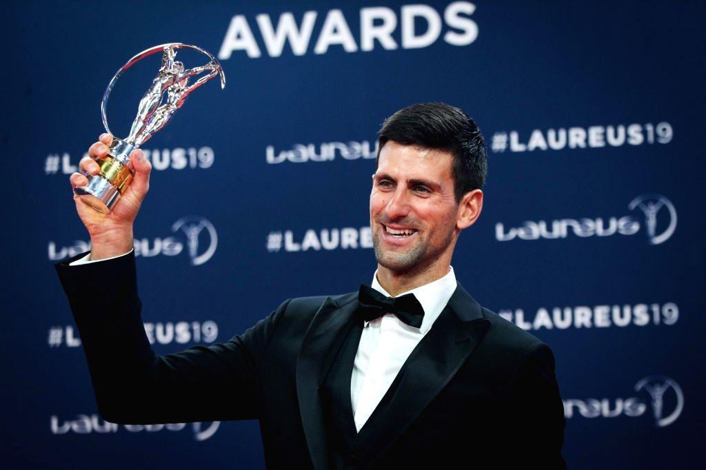MONACO, Feb. 19, 2019 - Sportsman of the Year winner Novak Djokovic shows the trophy after the 2019 Laureus World Sports Awards ceremony in Monaco, Feb. 18, 2019. The 2019 Laureus World Sports Awards ...