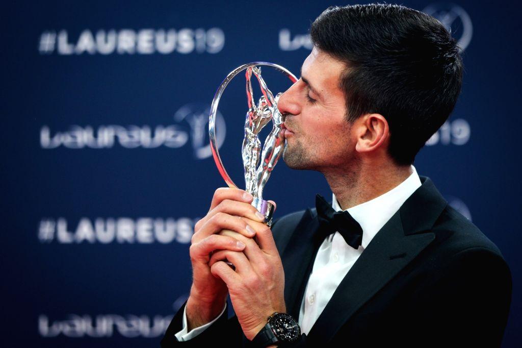 MONACO, Feb. 19, 2019 - Sportsman of the Year winner Novak Djokovic kisses the trophy after the 2019 Laureus World Sports Awards ceremony in Monaco, Feb. 18, 2019. The 2019 Laureus World Sports ...