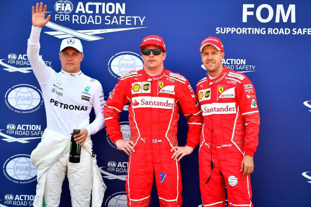MONACO, May 28, 2017 - (L to R) Mercedes driver Valtteri Bottas of Finland, Ferrari driver Kimi Raikkonen of Finland and German driver Sebastian Vettel pose after the qualification session of the ...