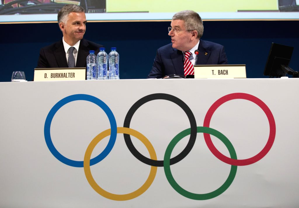 Photo povided by IOC shows International Olympic Committee (IOC) President Thomas Bach(R) talking to President of the Swiss Confederation Didier Burkhalter during the opening of the 127th IOC