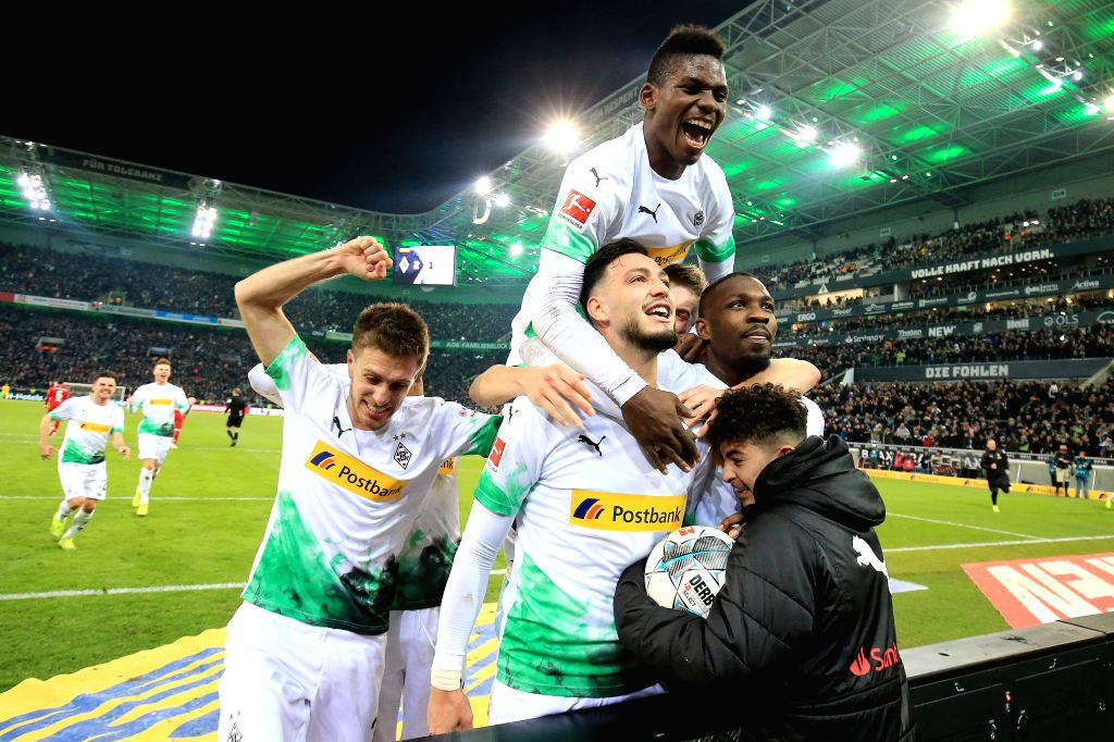MONCHENGLADBACH, Dec. 8, 2019 - Players of Monchengladbach celebrate after scoring during a German Bundesliga match between Borussia Monchengladbach and FC Bayern Munich in Monchengladbach, Germany, ...