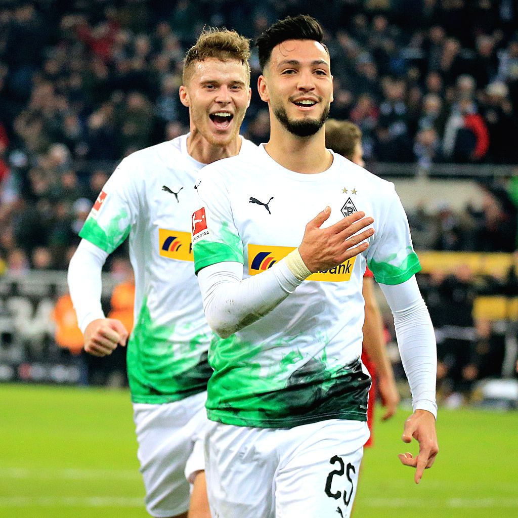 MONCHENGLADBACH, Dec. 8, 2019 - Rami Bensebaini (front) of Monchengladbach celebrates after scoring during a German Bundesliga match between Borussia Monchengladbach and FC Bayern Munich in ...